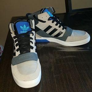 Men's Adidas high top shoes.